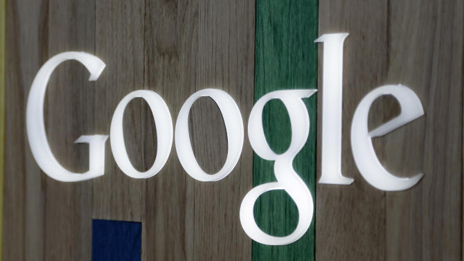 This April 9 2014 photo shows the Google logo at a store in Hialeah, Fla. Google reports quarterly financial results after the market close on Wednesday, April 16, 2014. (AP Photo/Alan Diaz)