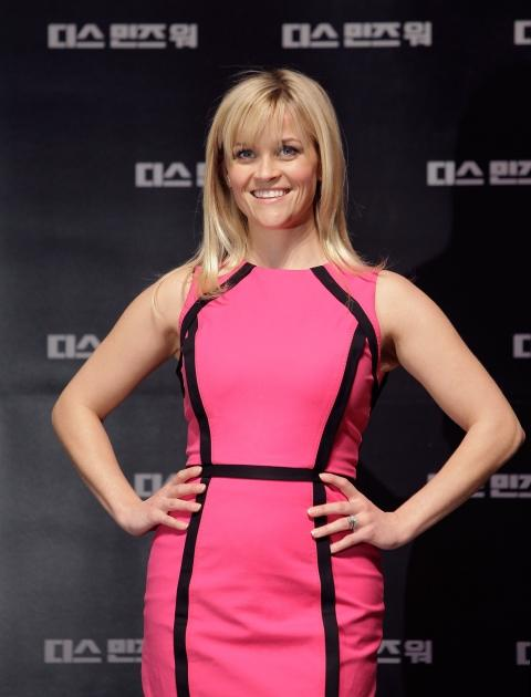 Reese Witherspoon is pretty in pink at the 'This Means War' press conference at Lotte Cinema in Seoul, South Korea, on February 23, 2012  -- Getty Images