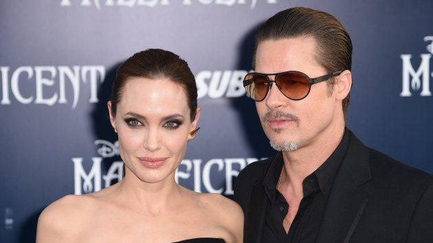 Angelina Jolie and Brad Pitt arrive for the world premiere of Disney's 'Maleficent,' May 28, 2014, at El Capitan Theatre in Hollywood -- Getty Images