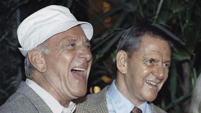 """FILE - In this Dec. 3, 1992 file photo, Jack Klugman, left, and Tony Randall laugh at a news conference announcing that they will reprise their most famous roles as Oscar Madison and Felix Unger respectively, for a one-night benefit performance of Neil Simons play, """"The Odd Couple"""", in Beverly Hills, Calif. Klugman, the prolific, craggy-faced character actor and regular guy who was loved by millions as the messy one in TV's """"The Odd Couple"""" and the crime-fighting coroner in """"Quincy, M.E.,"""" died Monday, a son said. He was 90. (AP Photo/Craig Fujii, File)"""