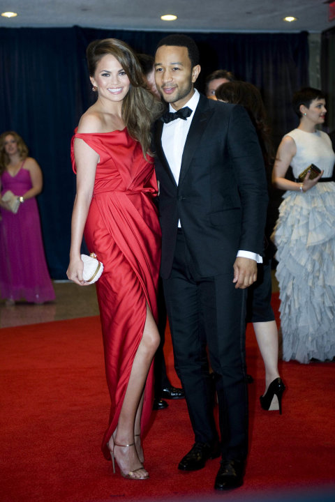 John Legend and Chrissy Teigen arrive at the White House Correspondents&amp;#39; Association Dinner on Saturday, April 28, 2012 in Washington.  (AP Photo/Kevin Wolf)