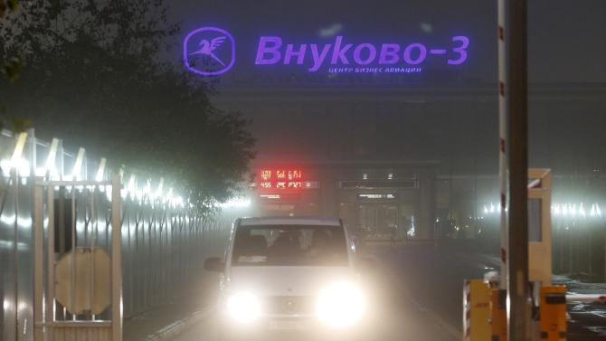 A car drives out of the Vnukovo-3 Business Aviation Center at Moscow's Vnukovo airport