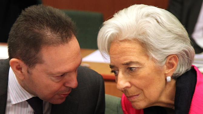 "International Monetary Fund managing director Christine Lagarde, right, talks with Greek Finance Minister Yannis Stournaras, during the Eurogroup finance ministers meeting in Brussels, Monday, Nov, 12, 2012. Greece's international lenders have prepared a ""positive"" report on the country's reform efforts, a crucial step in its efforts to secure the next installment of its bailout loan, the head the of group of finance ministers from the 17 euro countries said Monday. (AP Photo/Yves Logghe)"