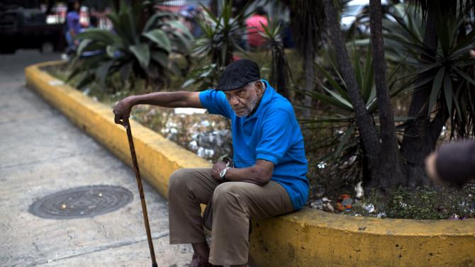 In this Feb. 19, 2014 photo, an old man rests alone in a square downtown in Caracas, Venezuela. There is plenty of discontent among the lower classes but the students have failed to capitalize on it. But Venezuela's poor are, on the whole, more worried about losing the pensions, subsidisies, education and health services gained under Chavez if the opposition were to come to power. (AP Photo/Rodrigo Abd)