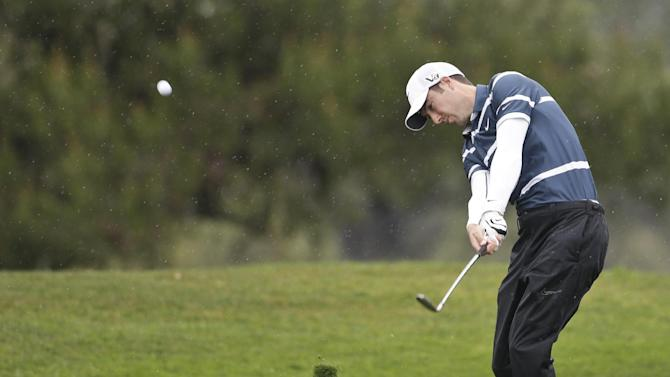 Ross Fisher, of England, hits his second shot to the second green on the South Course at Torrey Pines during the second round of the Farmers Insurance Open golf tournament Friday, Jan. 25, 2013, in San Diego. (AP Photo/Lenny Ignelzi)