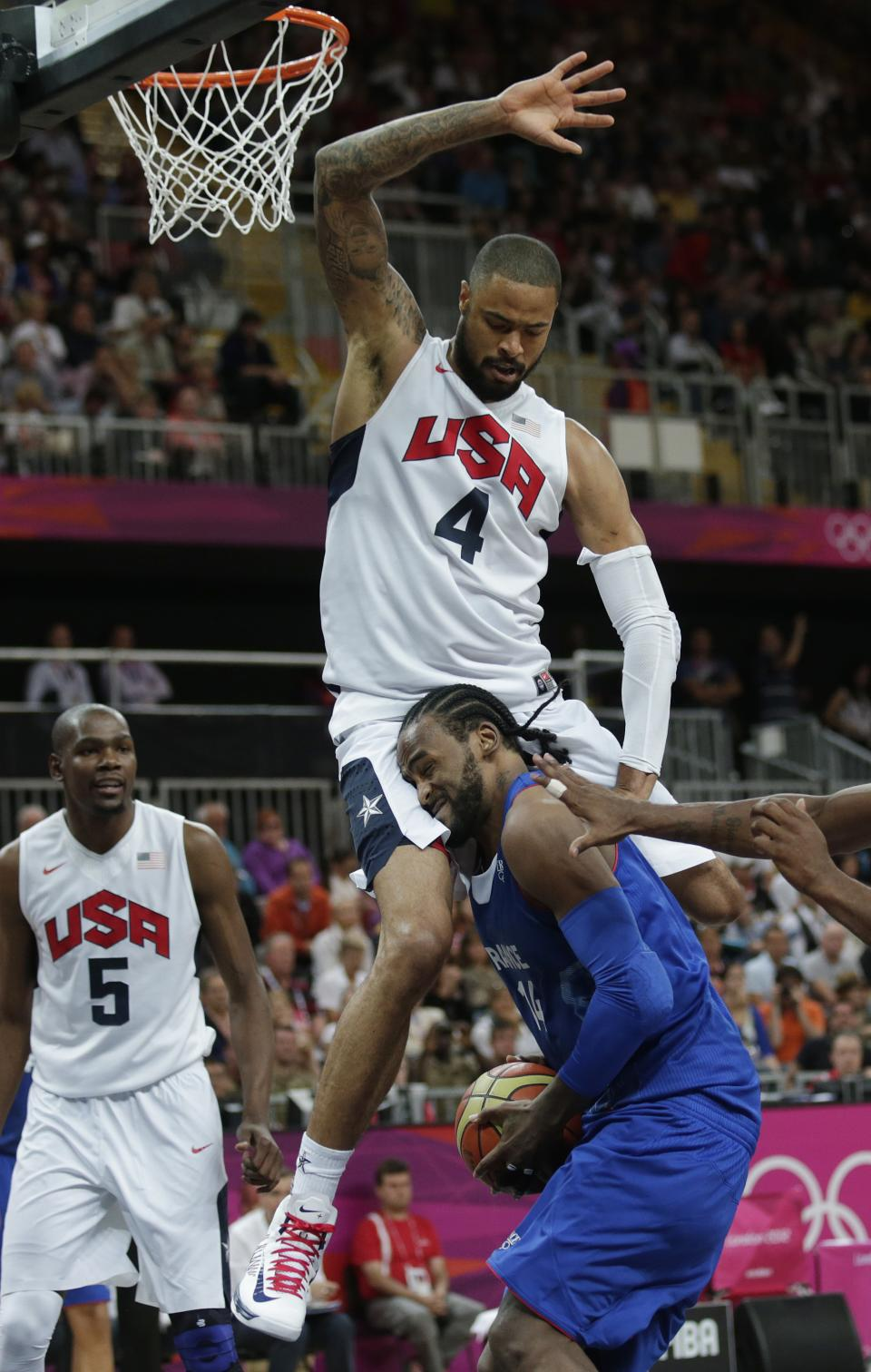 France's Ronny Turiaf is defended by USA's Tyson Chandler during the second half of a preliminary men's basketball game at the 2012 Summer Olympics, Sunday, July 29, 2012, in London. (AP Photo/Charles Krupa)