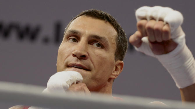 FILE - This is a Wednesday, Oct. 2, 2013 file photo of boxer Wladimir Klitschko of Ukraine attends an open training session in Moscow, Russia.Wladimir Klitschko will defend his WBA, IBF, WBO and IBO heavyweight titles against Australian challenger Alex Leapai in Oberhausen, Germany, on April 26. (AP Photo/Ivan Sekretarev, File)