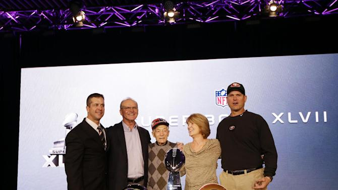 San Francisco 49ers head coach Jim Harbaugh and Baltimore Ravens head coach John Harbaugh pose with parents Jack and Jackie and grandfather Joe Cipiti during a news conference for the NFL Super Bowl XLVII football game Friday, Feb. 1, 2013, in New Orleans. (AP Photo/Matt Slocum)