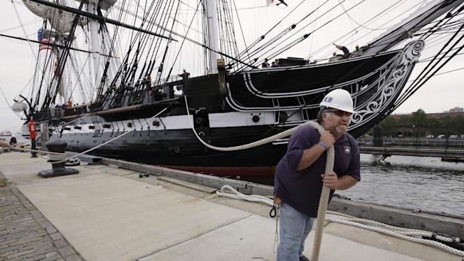 USS Constitution maintenance and repair crew member Michael Desmond, of Lynn, Mass., front, secures a line from the ship to the shore as the historic vessel is docked at her berth in Charlestown Navy Yard, in Boston, Sunday, Aug. 19, 2012. The USS Constitution, the U.S. Navy's oldest commissioned war ship, sailed under her own power for the first time since 1997 during an event Sunday. The sail was held to commemorate the 200th anniversary of the ship's victory over HMS Guerriere in the War of 1812. (AP Photo/Steven Senne)