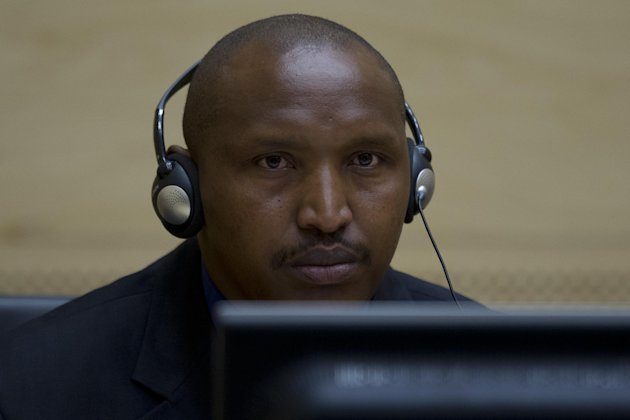 Rwandan-born warlord Bosco Ntaganda is seen during his first appearance before judges of the International Criminal Court in The Hague, Netherlands, Tuesday March 26, 2013, since his surprise surrender to face charges including murder, rape pillaging and using child soldiers in eastern Congo. Ntaganda had been one of the court's longest-sought fugitives until he unexpectedly became the first suspect to voluntarily turn himself in by seeking refuge last week at the U.S. Embassy in the Rwandan capital, Kigali. Ntaganda allegedly led rebels who terrorized eastern Congo in brutal tribal fighting from 2002 till 2003. (AP Photo/Peter Dejong)