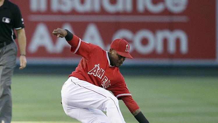 Los Angeles Angels shortstop Erick Aybar fields the ball hit by Baltimore Orioles' Nick Markakis during the first inning of a baseball game on Tuesday, July 22, 2014, in Anaheim, Calif. (AP Photo)