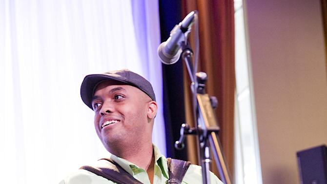 Accordionist Corey Ledet demonstrates the style that earned him a Grammy nomination, at the Only in Louisiana pre-Grammy brunch, on Saturday, Feb. 9, 2013,  at the Dorothy Chandler Pavilion in Los Angeles. (Photo by Colin Young-Wolff/Invision for LouisianaTravel.com/AP Images)