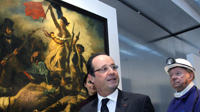 """France's President Francois Hollande, center, seen with a former miner, Lucien Laurent, right, in front of """" La Liberte Guidant le Peuple"""", a painting by Eugene Delacroix, during the inauguration of the Louvre Museum in Lens, northern France, Tuesday, Dec. 4, 2012. The museum in Lens is to open on Dec. 12, as part of a strategy to spread art beyond the traditional bastions of culture in Paris to new audiences in the provinces. (AP Photo/Michel Spingler, Pool)"""