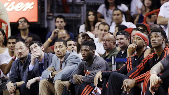 From left, Chicago Bulls' Kirk Hinrich, Derrick Rose, Nate Robinson, Richard Hamilton and Jimmy Butler watch from the bench during the final seconds of Game 2 of their NBA basketball playoff series in the Eastern Conference semifinals against the Miami Heat, Wednesday, May 8, 2013, in Miami. The Heat won 115-78. (AP Photo/Lynne Sladky)