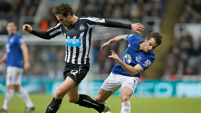 Everton's Leighton Baines challenges Newcastle United's Daryl Janmaat during their English Premier League soccer match at St James' Park in Newcastle