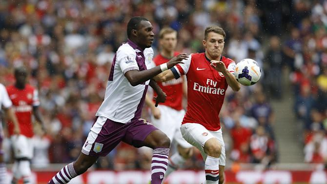 Arsenal's Aaron Ramsey, right, vies for the ball with Aston Villa's Christian Benteke during the English Premier League soccer match between Arsenal and Aston Villa at the Emirates Stadium in London, Saturday, Aug. 17, 2013. (AP Photo/Kirsty Wigglesworth)