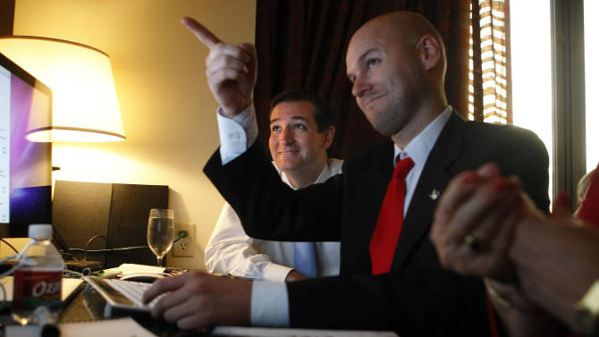 U.S. Senator candidate Ted Cruz, left, and his general consultant Jason Johnson look at early returns in his war room at the JW Marriott in the Galleria during his runoff election against rival Republican Lt. Gov. David Dewhurst for the U.S. Senate seat vacated by Kay Bailey Hutchison Tuesday, July 31, 2012, in Houston. (AP Photo/Houston Chronicle, Johnny Hanson)