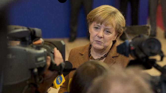 German Chancellor Angela Merkel speaks with the media after an EU summit in Brussels on Friday, Nov. 23, 2012. The leaders of Britain and France staked out starkly different visions of Europe's future as talks in Brussels on how much the European Union should be allowed to spend, set the stage for a long, divisive and possibly inconclusive summit. (AP Photo/Geert Vanden Wijngaert)