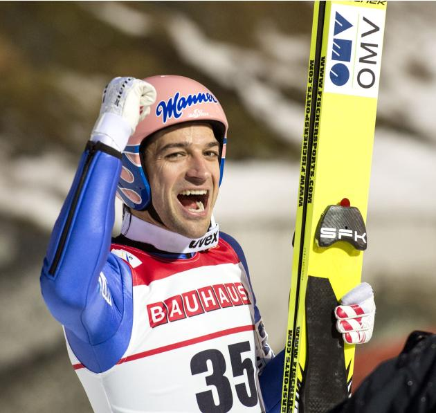 Kofler celebrates finishing second in the FIS World Cup skijumping event in Trondheim
