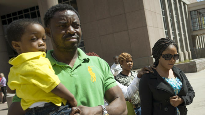 FILE - In this April 15, 2015 file photo, Pierre Collins, left, leaves court with his wife Yamah Collins, right, and family members in Minneapolis. Collins was sentenced to 40 years in prison Monday, Aug. 3, 2015 in the death of his 10-year-old son. He admitted Monday to striking the boy, binding him with duct tape and tossing him in the Mississippi River near Minneapolis, where the child's body was found weeks later. (Aaron Lavinsky/Star Tribune via AP, File) MANDATORY CREDIT; ST. PAUL PIONEER PRESS OUT; MAGS OUT; TWIN CITIES LOCAL TELEVISION OUT