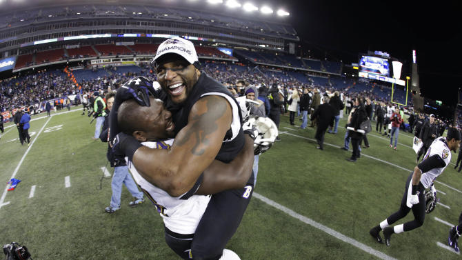 In this file photo taken Jan. 20, 2013, Baltimore Ravens inside linebacker Ray Lewis, right, celebrates with Vonta Leach after the NFL football AFC Championship football game against the New England Patriots in Foxborough, Mass. The Ravens are scheduled to face the San Francisco 49ers in Super Bowl XLVII in New Orleans on Sunday, Feb. 3. Leach's job is to get involved in a collision so  Rice won't. (AP Photo/Matt Slocum, file)