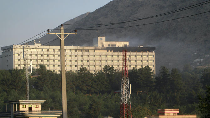 Smoke rises from the Inter-Continental hotel after it was attacked by militants in Kabul, Afghanistan, early Wednesday, June 29, 2011.   NATO helicopters were called in to help Afghan forces combat gunmen on the rooftop of the besieged Kabul hotel early Wednesday,  in a four-hour standoff with heavily armed Taliban fighters that left at least 10 Afghan civilians dead.  (AP Photo/Musadeq Sadeq)