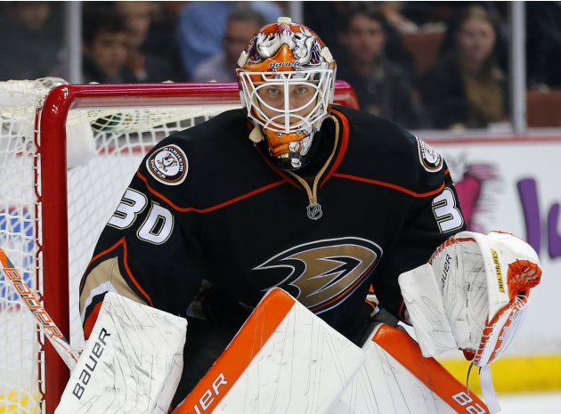 Anaheim Ducks goalie Viktor Fasth keeps his eyes on the puck during their NHL hockey game against the Calgary Flames in Anaheim