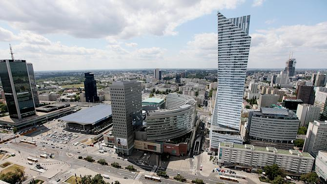 In this July 20, 2015 photo, the modern city skyline is seen from the Palace of Culture in Warsaw, Poland. For years, Poland's economy has grown, creating an economic boom in cities like Warsaw. But many small towns have not seen the improvement, and now voters are frustrated and threatening to throw out the pro-business ruling party Civic Platform in October elections. They already ousted a president in May who seemed out of touch with the daily struggle of regular Poles. (AP Photo/Czarek Sokolowski)