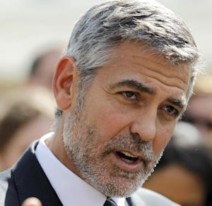 FILE - In this March 15, 2012 file photo, actor George Clooney speaks to reporters outside the White House in Washington. Clooney is offering more help to President Barack Obama's re-election campaign, headlining a European fundraiser this summer for Americans living abroad.  (AP Photo/Pablo Martinez Monsivais, File)