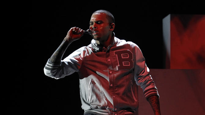 FILE - In this Feb. 12, 2012 file photo, Chris Brown performs during the 54th annual Grammy Awards, in Los Angeles. A judge in Los Angeles ordered a further review of Brown's community service on Monday, Sept. 24, 2012 and set another hearing to determine whether the singer is in compliance with the terms of his probation for the 2009 beating of then-girlfriend Rihanna. (AP Photo/Matt Sayles, File)