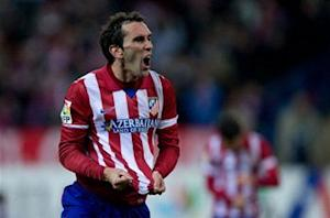 Atleti's Godin sees Barca as favorite in Champions League tie
