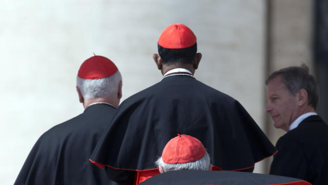 FILE - In this Wednesday, April 10, 2013 file photo cardinals line up to salute Pope Francis, not pictured, at the end of his weekly general audience in St. Peter's Square, at the Vatican. Pope Francis has named nine cardinals to advise him on running the church and reforming the Vatican bureaucracy. The Vatican announced Saturday, April 13, 2013 the members of the advisory panel and said they would hold their first meeting Oct. 1-3. They include current Vatican officials but more importantly cardinals from Europe, the Americas, Australia and Asia. (AP Photo/Alessandra Tarantino, File)