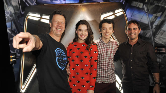 """Gavin Hood, far left, director of the forthcoming film """"Ender's Game,"""" poses with, left to right, cast members Hailee Steinfeld and Asa Butterfield and producer Bob Orci at a preview event for the film at the 2013 Comic-Con International Convention on Wednesday, July 17, 2013 in San Diego, Calif. (Photo by Chris Pizzello/Invision/AP)"""