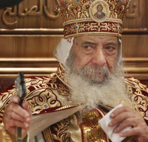 FILE - In this April 18, 2009 file photo, Pope Shenouda III, the head of Egypt's Coptic Orthodox Church, leads a midnight service to celebrate Christ's resurrection, at the Coptic Cathedral in Cairo, Egypt. Pope Shenouda III, the patriarch of the Coptic Orthodox Church who led Egypt's Christian minority for 40 years during a time of increasing tensions with Muslims, has died. He was 88. (AP Photo/Ben Curtis, File)
