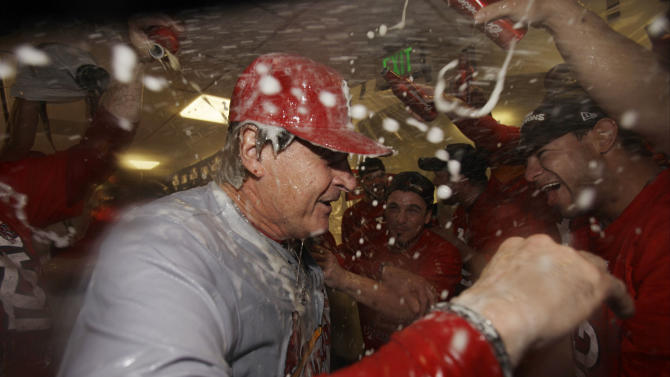 St. Louis Cardinals manager Tony La Russa and players celebrate after Game 6 of baseball's National League championship series against the Milwaukee Brewers Sunday, Oct. 16, 2011, in Milwaukee. The Cardinals won 12-6 to win the series and advance to the World Series. (AP Photo/David J. Phillip)
