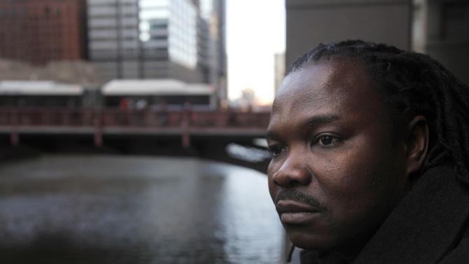 """In this photo taken Thursday, Feb. 16, 2012, Nigerian-born Charles Wiwa, 44, poses for a portrait in Chicago. Wiwa, fled Nigeria in 1996 following a crackdown on protests against Shell's oil operations in the Niger Delta. He and other natives of the oil-rich Ogoni region claim Shell was eager to stop protests in the area and was complicit in Nigerian government actions that included fatal shootings, rapes, beatings, arrests and property destruction. He said an American court is the only place the Ogonis can seek accountability. """"Nigeria gets so much money from oil. There is no way the company will be held liable for anything in courts in Nigeria,"""" said Wiwa, allowed into the United States as a political refugee. (AP Photo/Charles Rex Arbogast)"""