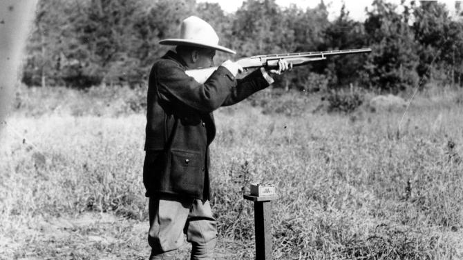FILE - In this Sept. 6, 1928 file photo, U.S. President Calvin Coolidge shoots at clay pigeons at his vacation home on the Brule at Superior, Wis, He scored twenty nine out of thirty seven.  (AP Photo/file)