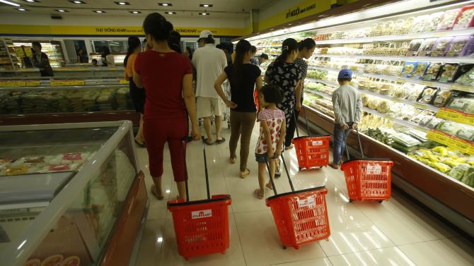 Customers shop at a Fivi mart in Hanoi