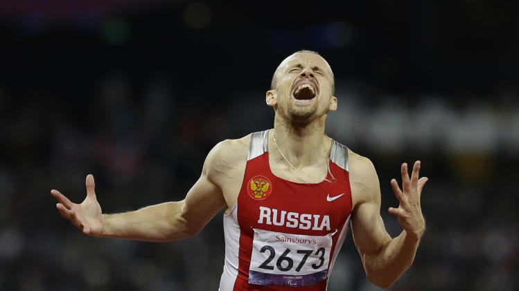 Russia's Alexey Labzin reacts as he crosses the finish line to win gold in the men's 400m T13 final at the 2012 Paralympics, Sunday, Sept. 2, 2012, in London. (AP Photo/Kirsty Wigglesworth)