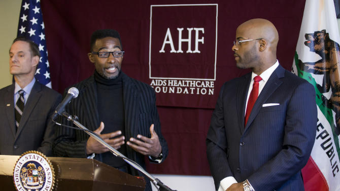 Darren James, former adult performer who contracted HIV while performing in the industry, middle, praises Assemblyman Isadore Hall, D-Los Angeles, right, for introducing legislation that will expand on a local Measure B approved by Los Angeles voters last November, during a news conference at the AIDS Healthcare Foundation,  in Los Angeles Thursday, Feb. 14, 2013. State Assembly Bill 332 will require condom use in all adult films produced in California. At left, Michael Weinstein, President of AHF. (AP Photo/Damian Dovarganes)