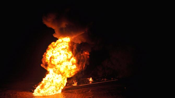 Fire burns after tug, barge hit La. gas pipeline
