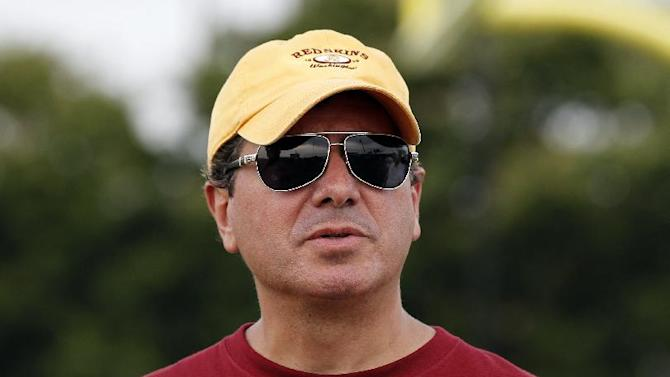 Washington Redskins owner Daniel Snyder pauses on the field after practice at the team's NFL football training facility, Sunday, July 27, 2014, in Richmond, Va