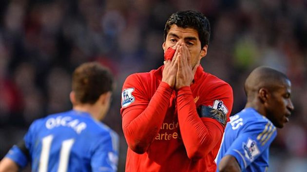 Liverpool's Luis Suarez reacts against Chelsea (AFP)