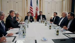U.S. Secretary of Energy Ernest Moniz, U.S. Secretary of State John Kerry and U.S. Under Secretary for Political Affairs Wendy Sherman meet with Iranian Foreign Minister Mohammad Javad Zarif at a hotel in Vienna