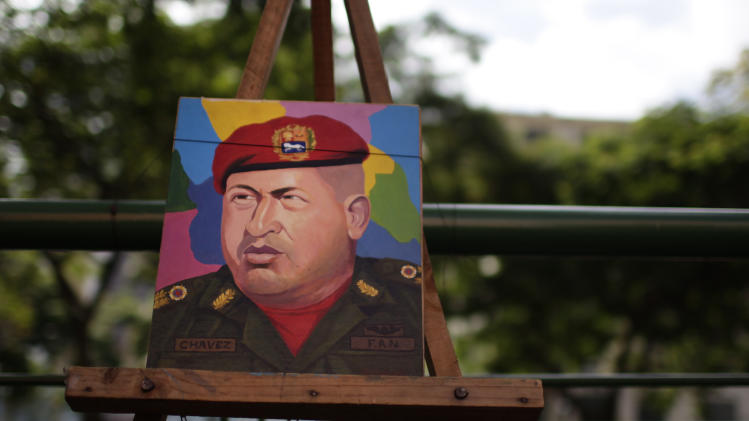 A painting of Venezuela's President Hugo Chavez sits for sale on an easel at an artist's stand in the street in Caracas, Venezuela, Friday March 2, 2012.  Chavez has been in Cuba since last Friday to have a growth removed in the same part of the pelvis where a larger, malignant tumor was extracted last year.  Chavez said Friday he's recovering quickly from tumor surgery, that doctors have put him on a special diet, and that he's taking daily walks. (AP Photo/Ariana Cubillos)