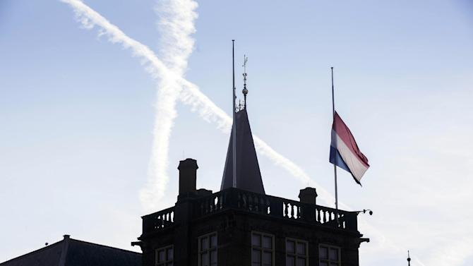 A flag flies half-staff at Binnenhof, the seat of the Dutch government, in The Hague, Netherlands, Friday, July 18, 2014. Flags are flying half-staff across the Netherlands as the country mourns at least 154 of its citizens killed when a Malaysia Airlines passenger jet was shot down in eastern Ukraine. (AP Photo/Phil Nijhuis)