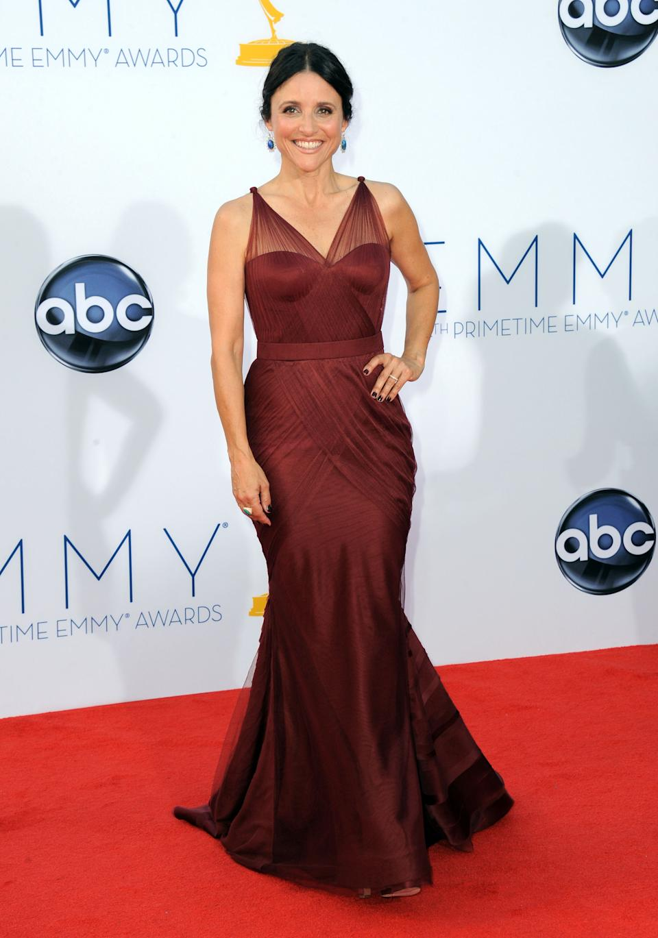 Actress Julia Louis-Dreyfus arrives at the 64th Primetime Emmy Awards at the Nokia Theatre on Sunday, Sept. 23, 2012, in Los Angeles.  (Photo by Jordan Strauss/Invision/AP)