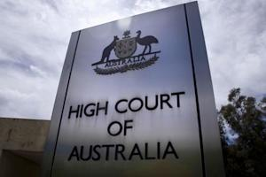 A sign stands outside the High Court of Australia in…