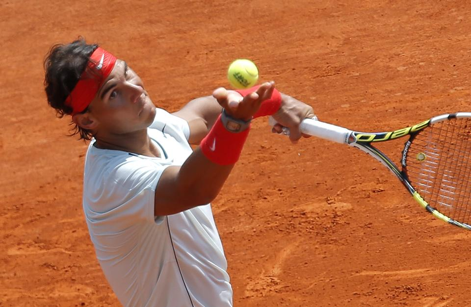 Spain's Rafael Nadal serves the ball to Marinko Matosevic of Australia during their match of the Monte Carlo Tennis Masters tournament in Monaco, Wednesday, April 17, 2013. (AP Photo/Lionel Cironneau)