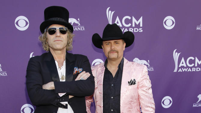 """FILE - This April 1, 1012 file photo shows Big Kenny, left, John Rich, of musical group Big and Rich, arriving at the 47th Annual Academy of Country Music Awards in Las Vegas.  After a five-year break, Big & Rich are putting the funny back in country music _ with the help of Jon Bon Jovi and Richie Sambora.The unlikely quartet gathered to write two songs for the country duo's new album """"Hillbilly Jedi"""" after they struck up a friendship a few years back. (AP Photo/Isaac Brekken, file)"""